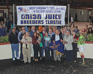 Trainer Gary Williams, Jr., jockey Jose Montano, and friends celebrate Follow the Notion's win in the WV Thoroughbred Breeders Association Onion Juice Breeders Classsic. Runnin'toluvya won the WV Vincent Moscarelli Memorial Breeders Classic. Photo by Coady Photography.