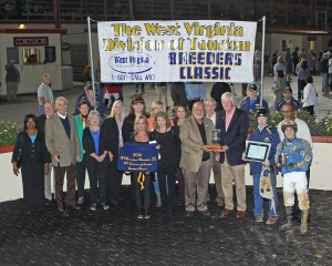 Trainer John A. Casey, jockey Grant Whitacre, and friends celebrate Romantic Cork's win in the WV Division of Tourism Breeders Classic. Runnin'toluvya won the WV Vincent Moscarelli Memorial Breeders Classic. Photo by Coady Photography.